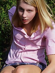 Blonde teen with shaved pussy posing in the country