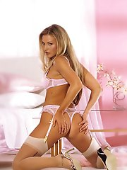 Sexy blonde in pink lingerie and beige nylons open her kitty for us